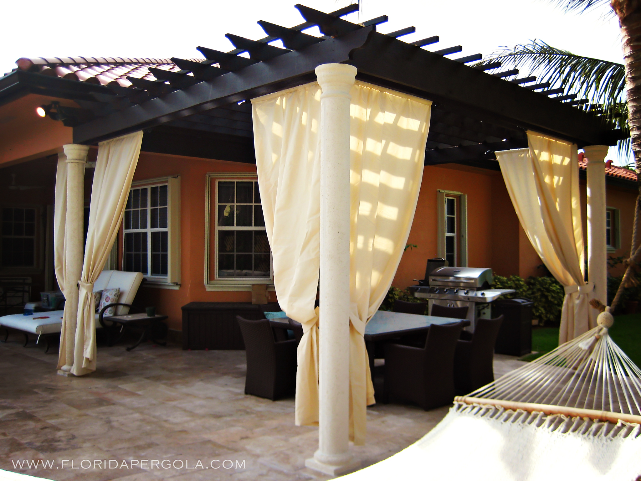 Traditional pergola with sunbrella curtains
